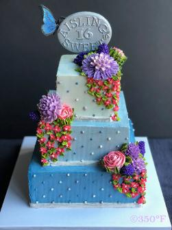 A floral buttercream tiered cake and a handmade sugar topper for a sweet 16.