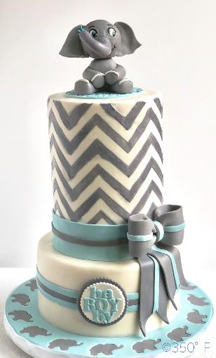 baby shower cake with baby elephant cake topper