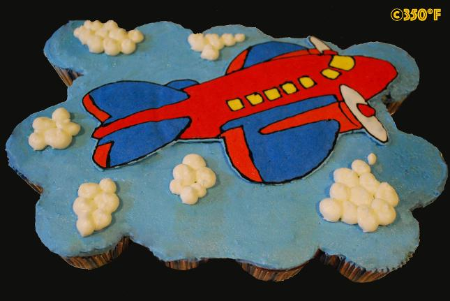A custom pull apart cupcake platter for an airplane themed birthday party for toddler