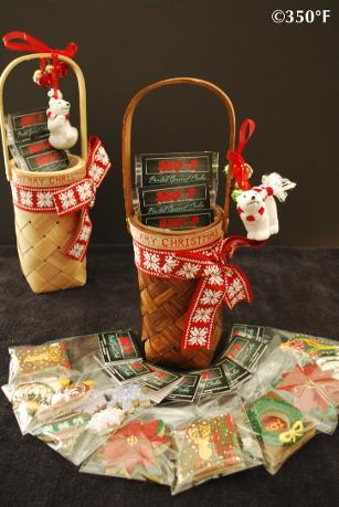 Baskets bursting with decorated cookies decked up in red and white ribbons and cute polar bear christmas tree ornaments to be given away as holidays gifts to friends and family