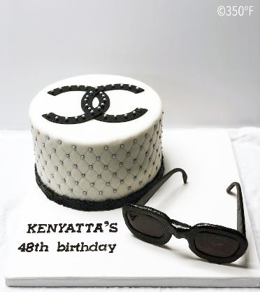 A custom Coco Chanel themed birthday cake complete with edible sunglasses made of sugar!