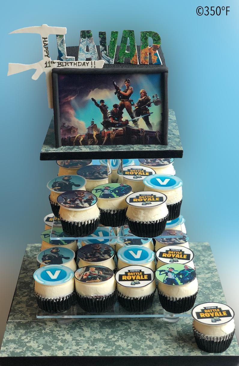 Fortnite themed birthday dessert tower with cake and cupcakes