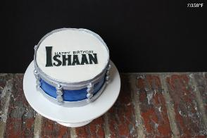 A personal birthday cake for a budding rock drummer with birthday inscription in Beatles style