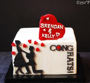 a simple and elegant engagement cake with a silhouette of the love birds