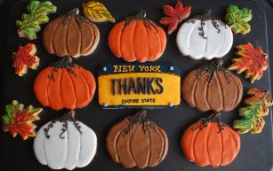 Pumpkins, fall leaves and a license plate that says Thanks make this custom decorated cookie set a lovely host gift for a Thanksgiving dinner party