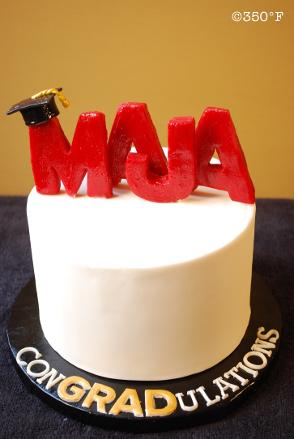 A simple signature graduation cake with name of the graduate in whimsical 3D letters