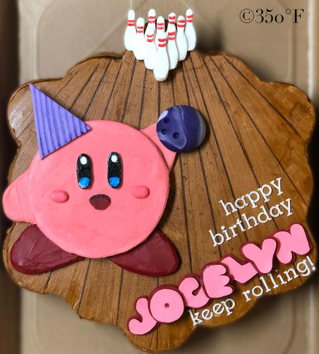 A pull apart cupcake cake for a 6th birthday party at a bowling alley, featuring Kirby, Jocelyn's favorite TV character