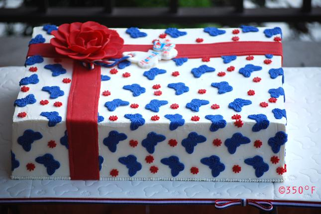 A gift cake decorated in july 4th theme with red, white and blue chocolate cut outs