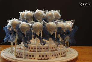 Silver cake pops as birthday party favors for a pinball themed kid's party