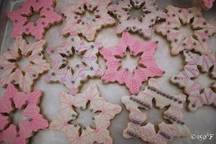 Pink, white and silver snowflake cookies for a winter wonderland themed sweet 16 party