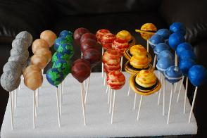Planet cake pops for an astronomy themed baby shower, also perfect for a science themed children's birthday party