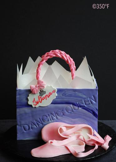 A birthday cake in the shape of a shopping bag for a ballerina