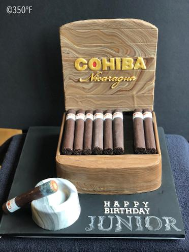 A cigar box cake accessorized with a personal ashtray cake for a 40th birthday party