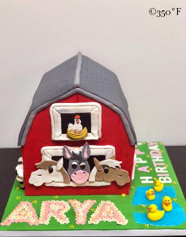 A red barn cake for Arya's 5th birthday party