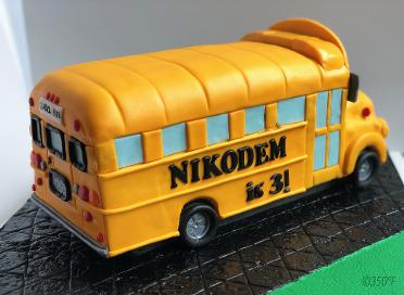 A sculpted, fondant, school bus cake for a little boy's 3rd birthday