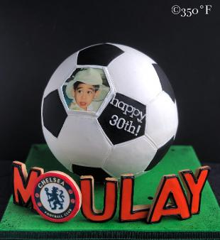 Chelsea themed soccer ball cake with name spelt in cookie
