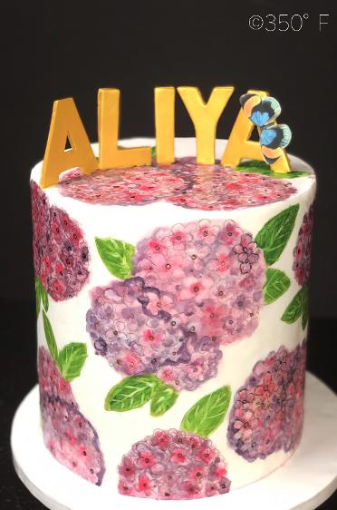 Handpainted hydrangeas make this Korean first birthday cake a special one for baby Aliya.
