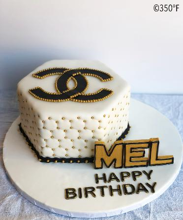 Coco Chanel themed Diva cake in white, black and gold with custom edible name accent