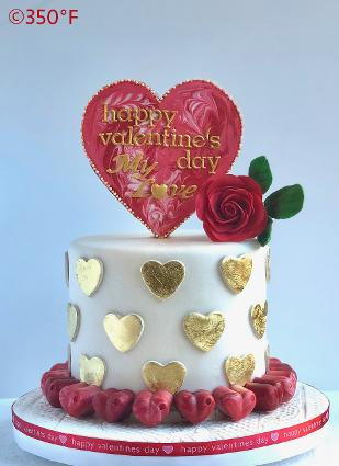 Valentine's Day cake with cookie topper and chocolate truffles decor