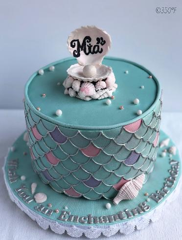 A mermaid themed fondant cake with chocolate shells and pearls for a little mermaid's birthday.