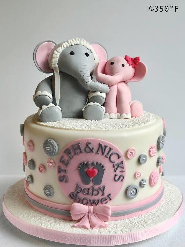 baby shower cake with mama and baby girl elephant toppers