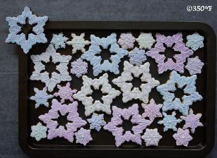Snowflake cookies set in white, blue and lavender for the holiday season