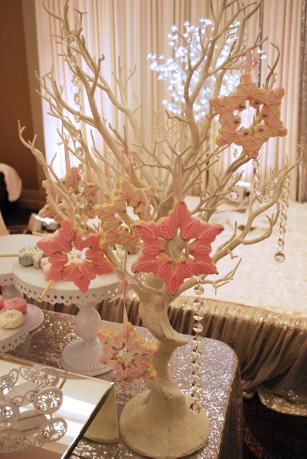 Snowflake cookies hanging on a dessert tree at a Sweet 16 party