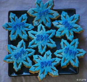 Custom monogram snowflake cookies for a winter theme birthday party favor