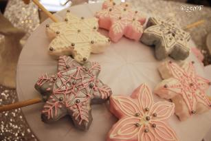 Snowflake rice krispie pops adorn a Winter Wonderland dessert table