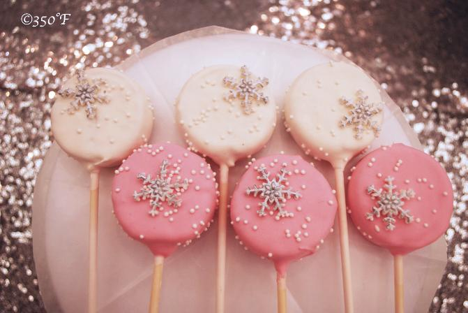 Dainty snowflake cake pops looking lovely on a Winter Wonderland dessert table at a Sweet 16 celebration