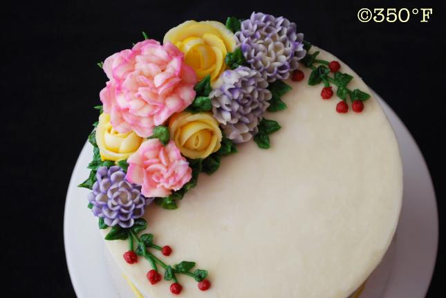 A floral buttercream cake looking pretty and tasty - a after-dinner dessert of mocha cake and caramel filling