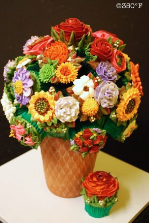 A beautiful cupcake bouquet with a variety of colorful flowers for a holiday party
