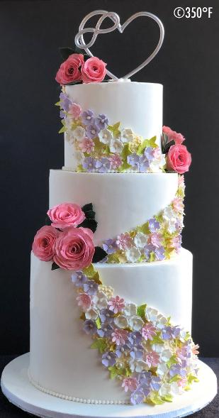 floral wedding cake with infinite love cake topper