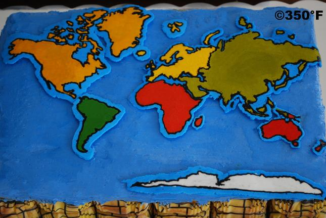 A pull apart cupcake platter sporting the world map for international theme birthday party